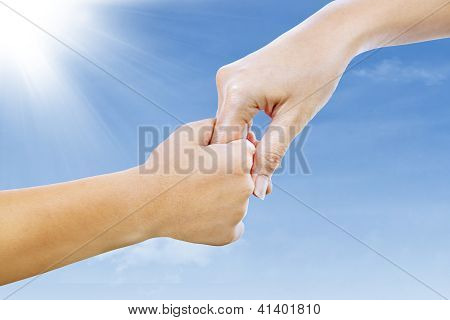 Helping Hand Under Blue Sky