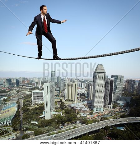 Balancing businessman and cityscape