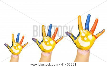 Family concept. Three colorful hands with smiling face of family - mother, father and baby. Small, m