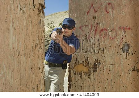 Caucasian man attacking with handgun at combat training