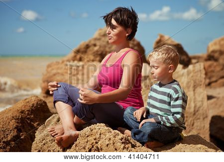 Mother And Son In Sitting Relaxation Pose