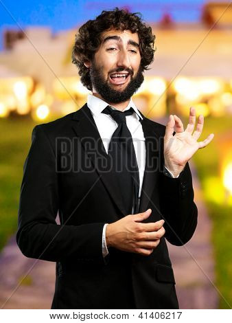 Portrait Of A Funny Businessman standing in front of a restaurant