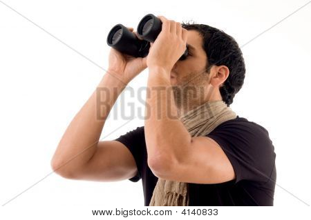 Side Pose Of Man Looking Through Binocular