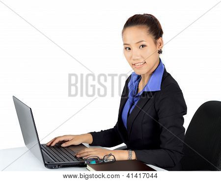Isolated Young Business Woman Working On A Desk.