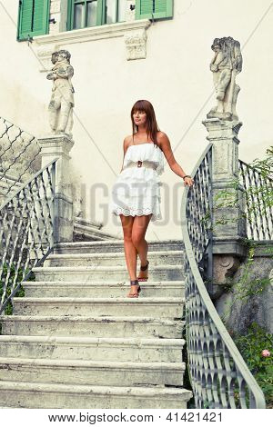 Beautiful Woman Stepping Down Stair