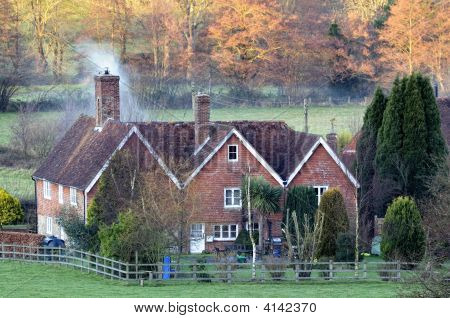 Snug English Country House At Dusk As Autumn Turns To Winter