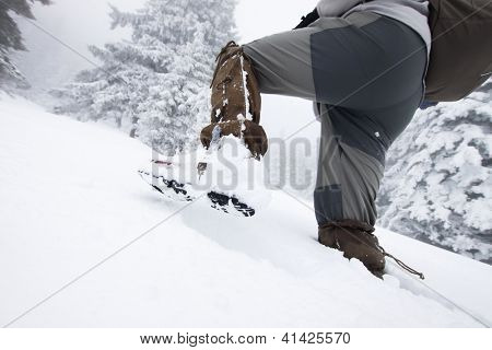 Man trekking in big snow