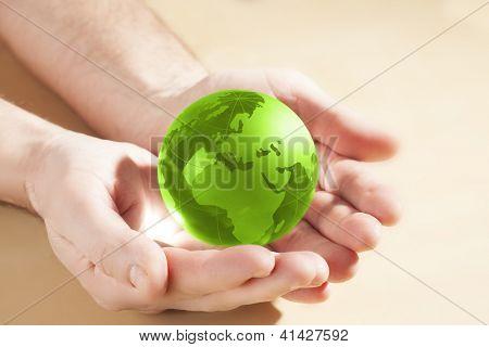 green glass globe in hand