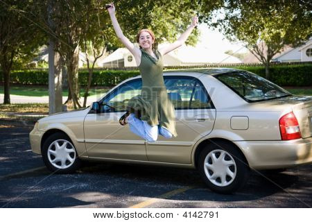 Teen With Car Jumps For Joy