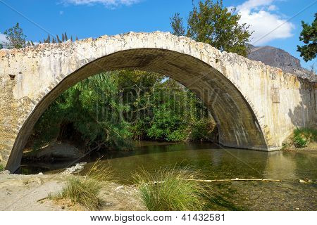 Historic stone bridge on Crete island