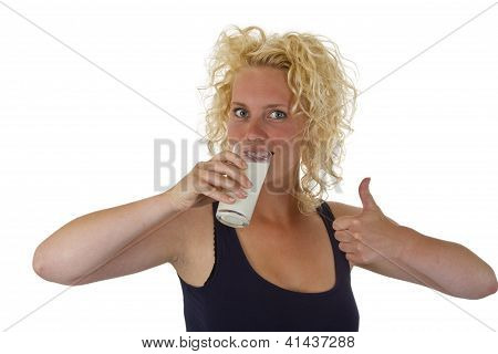 Young Woman Drinking Glass Of Fresh Milk