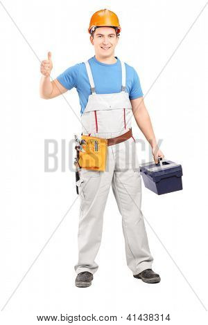 Full length portrait of a manual worker holding a tool box and giving a thumb up isolated on white background