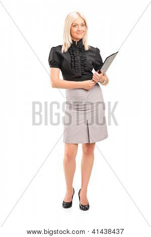 Full length portrait of a blond businesswoman holding a clipboard isolated on white background