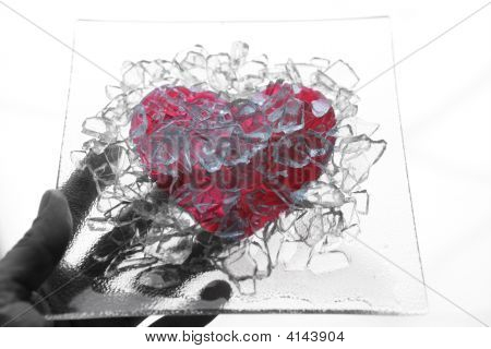 Hand Holding A Broken Glass Heart