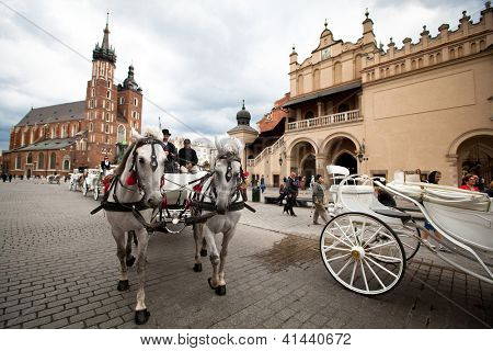 KRAKOW, POLAND - JULY 18: Main Square - historical center of Krakow, May 18, 2012 in Krakow, Poland. This year the city was visited by 8.1 million tourists, which is the highest level.