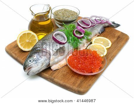 Trout, Vegetables, Spices And Red Caviar On White Background