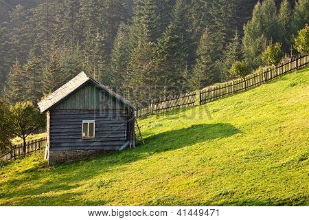 Landscape with outhouse
