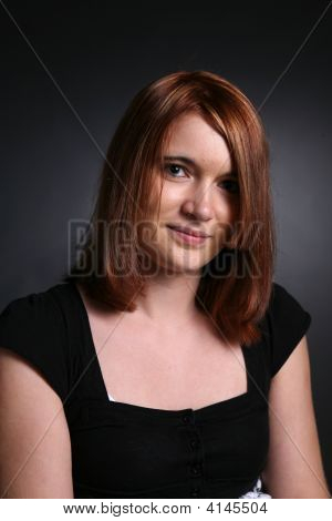 Pretty Auburn Haired Teen In Black Shirt