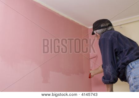 Mann Painting A Wall