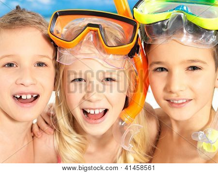 Portrait Of The Happy Children Enjoying At Beach