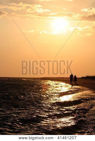 Sunset on Island Shore with Silhouetted Couple