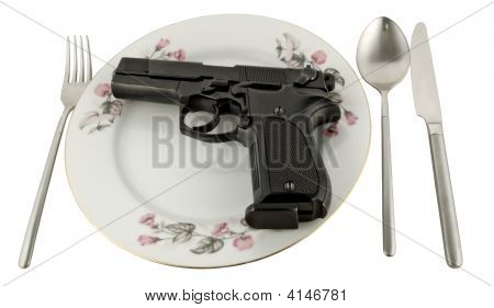 Pistol In A Plate On The Served Table