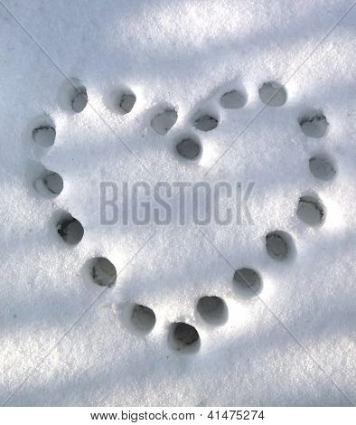 heart on snow trail
