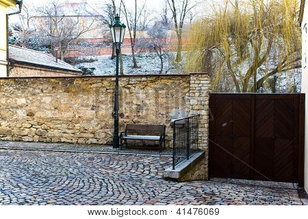Old Street With Benches And A Lantern.