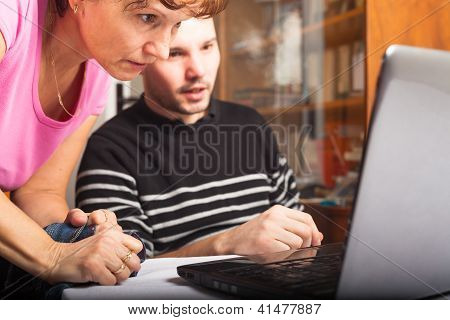 People Looking At Laptop
