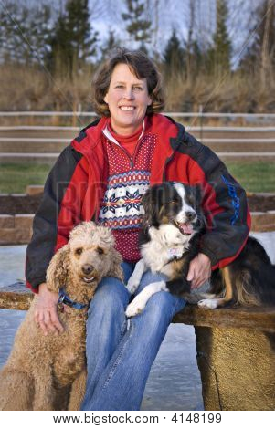 Woman And Her Dogs Focus On Woman's Face
