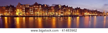 Panorama from Amsterdam with the Munt tower in the Netherlands at twilight