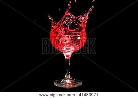 Ice cube splashing in a glass of wine