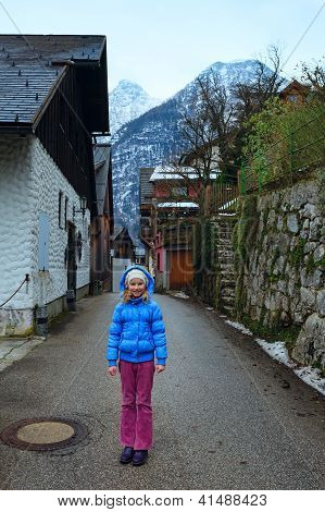 Girl In Hallstatt Town  (austria). Winter View.