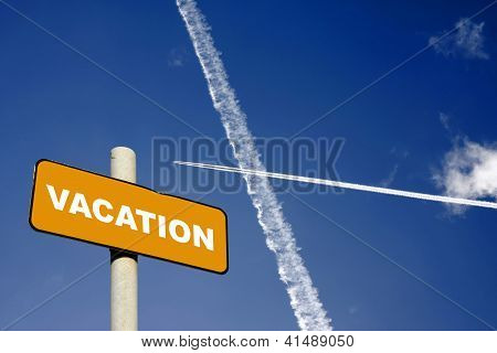 Vacation Sign With Jet Trails In A Dark Blue Sky