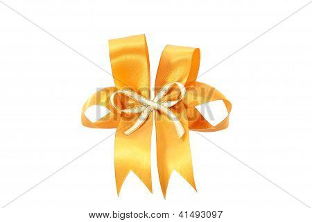Big Gold Holiday Bow On White Background.