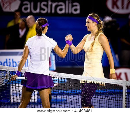 MELBOURNE - JANUARY 26: Victoria Azarenka (R) of Belarus after beating Li Na (L)of Chins to win the 2013 Australian Open on January26, 2013 in Melbourne, Australia.