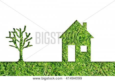 Conceptual house symbol or metaphor with a green tree at horizon made of fresh summer or spring grass isolated on white background