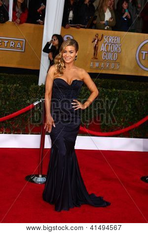 LOS ANGELES - JAN 27:  Carmen Electra arrives at the 2013 Screen Actor's Guild Awards at the Shrine Auditorium on January 27, 2013 in Los Angeles, CA