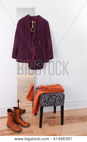 Purple Jacket Hanging On A Mirror