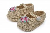 image of booty  - Ecru crochet baby booties with flowers isolated on white Hand - JPG