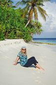 picture of kuramathi  - Young woman on white sand beach on Maldivian island - JPG