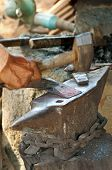 picture of blacksmith shop  - Forging a hammer head in a traditional blacksmith shop Cambodia - JPG