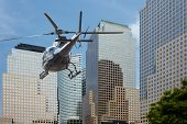 foto of rescue helicopter  - Helicopter flying between the scyscraper of manhattan south - JPG
