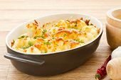 stock photo of crisps  - cauliflower baked with egg and cheese with dill