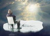 stock photo of ice fishing  - An fisherman floating on the iceberg - JPG