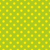 Seamless fresh spring pattern or texture with yellow polka dots on grass green background