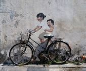 PENANG, MALAYSIA-DEC.9: Street Mural entitled 'LIttle Children on a Bicycle' painted by Ernest Zacha