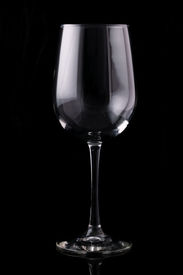 image of wine-glass  - Isolated wine glass on a black background - JPG