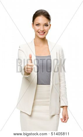 Half-length portrait of businesswoman who thumbs up, isolated on white. Concept of leadership and success