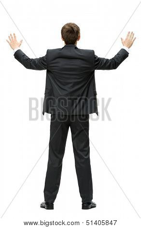 Full-length backview of businessman with hands up, isolated on white. Concept of leadership and success